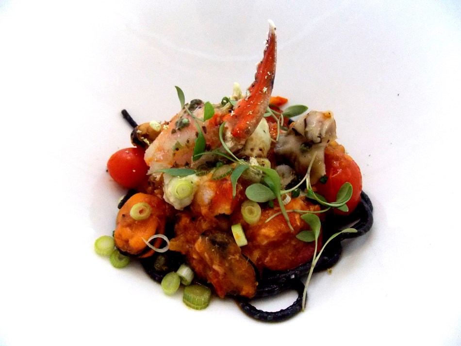 Lobster and seafood on homemade black pasta